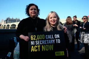 Derry Girls cast members Siobhan McSweeney and Nicola Coughlan (right) join MPS and women impacted by Northern Ireland's strict abortion laws on Westminster Bridge in London to demand legislative change