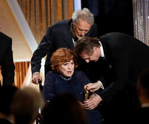 Honoree Maureen O'Hara receiving an Honorary Award Oscar statuette from actors Clint Eastwood and Liam Neeson