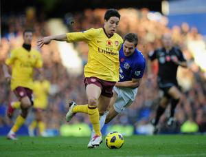 LIVERPOOL, ENGLAND - NOVEMBER 14:  Samir Nasri of Arsenal is challenged by Phil Jagielka of Everton during the Barclays Premier League match between Everton and Arsenal at Goodison Park on November 14, 2010 in Liverpool, England.  (Photo by Shaun Botterill/Getty Images)