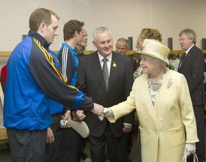 Queen Elizabeth II and GAA President Christy Cooney (centre) meet players during a tour of Croke Park, Dublin, during the second day of her State Visit to Ireland. PRESS ASSOCIATION Photo.