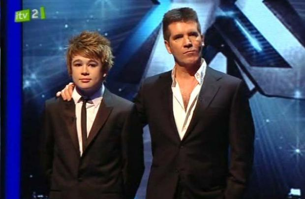 Eoghan Quigg and Simon Cowell react as the X Factor final results are announced