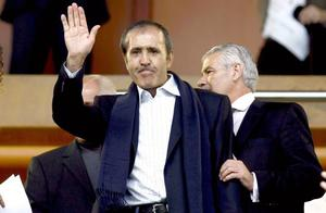 Golf legend Seve Ballesteros waves as he appears in public for the first time after surgery on a cancerous brain tumor next to Racing de Santander's president Miguel Angel Revilla, right, before a Spanish La Liga soccer match between Racing de Santander and Almeria at the Sardinero stadium in Santander, Spain, on Sunday , May 3, 2009.