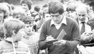 Seve Ballesteros: Golf/ At Moyola Park Golf Club. 4/8/1980 Young autograph hunters surround the Spanish star.