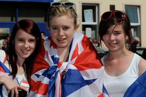 Lauren Murphy, Megan Boucher and Emma McGraw enjoy the summer sunshine at the County Londonderry Twelfth celebration in Limavady