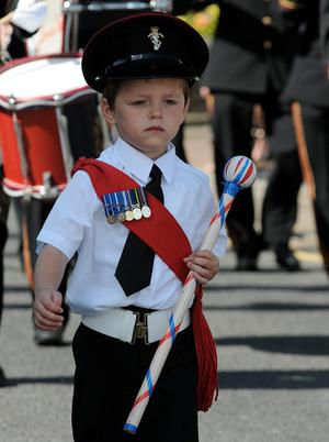 A young boy takes his duties with Ardinariff Flute Band seriously in Limavdy