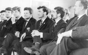 "The ""Bearded ones"" of Methodist College pictured with principal, Mr. A.S. Worrall, casting a keen eye along the row of sixth-form whiskers, 1964."