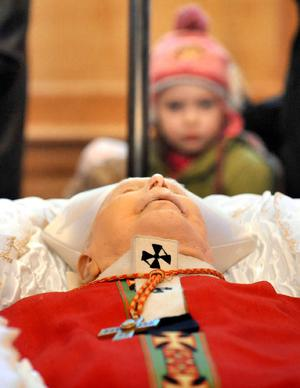 Cardinal Daly lying in state at St Peter's Cathedral in west Belfast