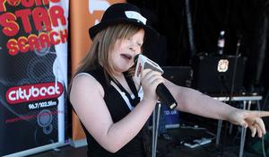 11 year old Chantelle mc Ateer  on stage performing at the City Beat Young Star search heat  held in the Wallace Park Lisburn