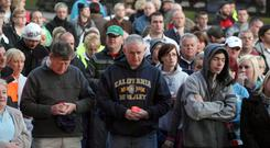 Darkness and light: bereaved relatives take part in a march in Belfast