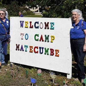 Former Pedro Pan children pose at Camp Matecumbe, where many children were housed after arriving in the US from Cuba in the early 60s (AP)