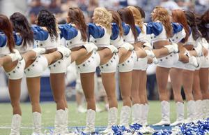 Cheerleaders of the Dallas Cowboys perform on the field during the NFL game against the St. Louis Rams