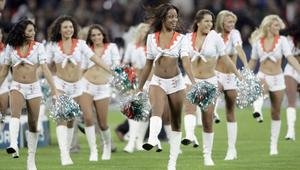 Cheerleaders perform prior to the NFC Eastern Division match between Miami Dolphins and New York Giants at Wembley, London.