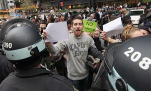 NEW YORK, NY - NOVEMBER 15: Protesters carry copies of a court order outside Zuccotti Park after police removed the Occupy Wall Street protesters from the park early in the morning on November 15, 2011 in New York City. Hundreds of protesters, who rallied against inequality in America, have slept in tents and under tarps since September 17 in Zuccotti Park, which has since become the epicenter of the global Occupy movement. The raid in New York City follows recent similar moves in Oakland, California, and Portland, Oregon. (Photo by Mario Tama/Getty Images)