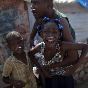 Clouds of choking irritants blew into shelters of thousands made homeless by the Haiti earthquake (AP)