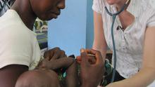 Dr Shona Johnston treats a child at the Ola During Children's Hospital, in Freetown
