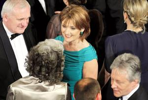 Iris Robinson with Bertie Ahern (left) and husband Peter Robinson (right)at the State Dinner in honour of the Queen and the Duke of Edinburgh, at Dublin Castle.