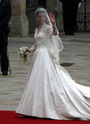 Kate Middleton waves as she arrives at Westminster Abbey ahead of her wedding with Prince William. PRESS ASSOCIATION Photo. Picture date: Friday April 29, 2011. Photo credit should read: Steve Parsons/PA Wire