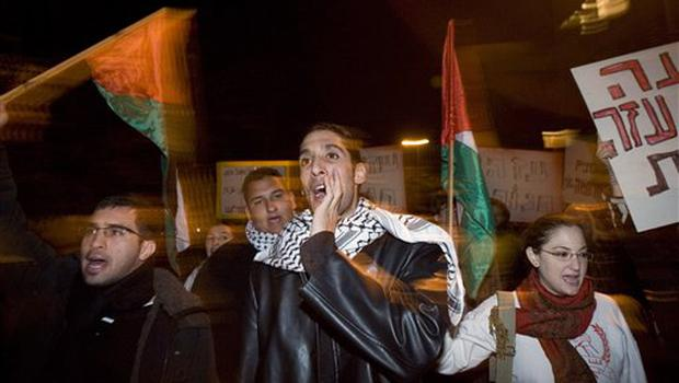 Israeli Arabs and left wing activists wave Palestinians flags during a protest against the Israeli strikes on the Gaza Strip in Tel Aviv, Israel, Saturday, Dec. 27, 2008. Israeli warplanes retaliating for rocket fire from the Gaza Strip pounded dozens of security compounds across the Hamas-ruled territory in unprecedented waves of airstrikes Saturday, killing more than 200 people and wounding nearly 400 in the single bloodiest day of fighting in years. (AP Photo/Ariel Schalit)