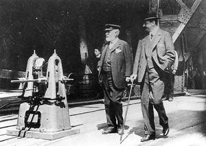 Lord Pirrie, chairman of H&W (left) and Bruce Ismay, chairman of White Star, make a final tour of inspection of Titanic before her launch.  31/5/1911. Photograph © National Museums Northern Ireland. Collection Ulster Folk & Transport Museum