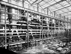 The Titanic's two main engines near completion in engine works erecting shop. Photograph © National Museums Northern Ireland. Collection Harland & Wolff, Ulster Folk & Transport Museum