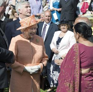 The Queen meets guests during a garden party in honour of her Diamond Jubilee at the Sandringham Estate in Norfolk
