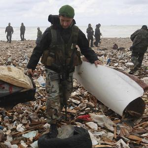 Lebanese soldiers gather debris from the Ethiopian Airlines plane that crashed in the sea (AP)