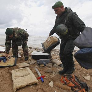 Lebanese soldiers retrieve debris washed ashore from the Ethiopian Airlines plane that crashed (AP)