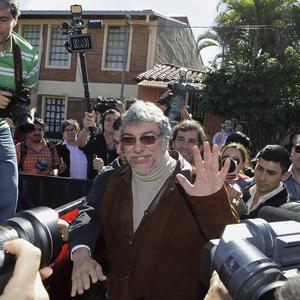Paraguay's former president Fernando Lugo, centre, outside his home on the outskirts of Asuncion, Paraguay (AP/Jorge Saenz)