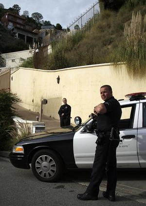 Los Angeles Police officers stand outside the home of actress Brittany Murphy's husband British screenwriter Simon Monjack, in Los Angeles