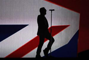 Bono and U2 perform at the Brit Awards 2009 at Earls Court exhibition centre in London, England, Wednesday, Feb. 18, 2009. (AP Photo/MJ Kim)