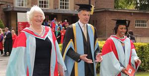 Vice Chancellor Peter Gregson leads the graduation procession along with Dame Mary Peters and Dame Kelly Holmes.