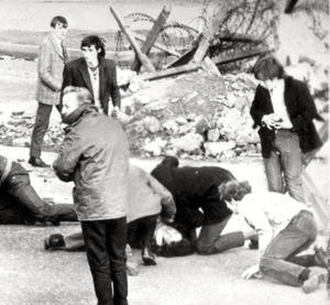 A  man receiving attention during  Bloody Sunday.