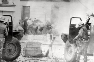 Soldiers taking cover behind their sandbagged armoured cars during  Bloody Sunday