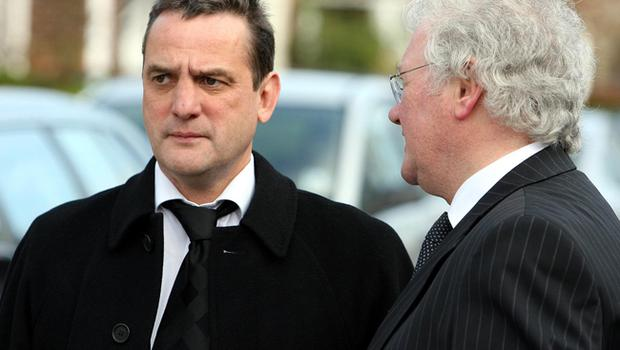 Phil Taylor, George Best's agent and Jackie Fullerton at George Best's funeral