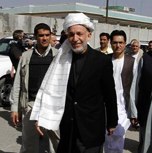 Hamid Karzai threatened to join the Taliban, according to several members of parliament