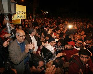 CAIRO, EGYPT - JANUARY 30:  Opposition leader Mohamed ElBaradei waves to supporters in Tahrir Square on January 30, 2011 in Cairo, Egypt. Cairo remained in a state of flux and marchers continued to protest in the streets and defy curfew, demanding the resignation of Egyptian president Hosni Mubarek. As President Mubarak struggles to regain control after five days of protests he has appointed Omar Suleiman as vice-president. The present death toll stands at 100 and up to 2,000 people are thought to have been injured during the clashes which started last Tuesday. Overnight it was reported that thousands of inmates from the Wadi Naturn prison had escaped and that Egyptians were forming vigilante groups in order to protect their homes.   (Photo by Peter Macdiarmid/Getty Images)