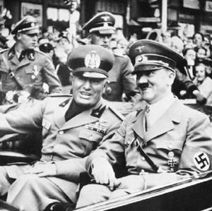 Adolf Hitler pictured in 1938 with Italian dictator Benito Mussolini