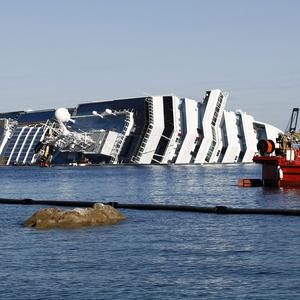 Passengers who escaped unharmed from the grounded cruise ship Costa Concordia are being offered compensation(AP)