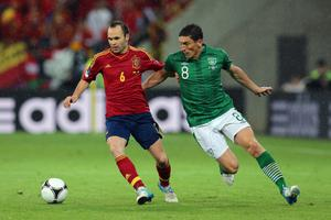 GDANSK, POLAND - JUNE 14: Andres Iniesta of Spain and  Keith Andrews of Republic of Ireland compete for the ball during the UEFA EURO 2012 group C match between Spain and Ireland at The Municipal Stadium on June 14, 2012 in Gdansk, Poland.  (Photo by Alex Grimm/Getty Images)