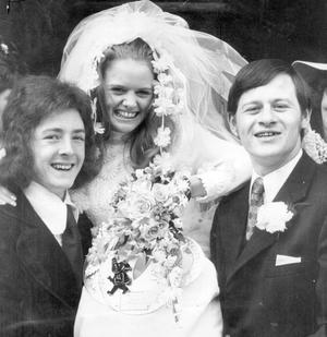 Alex Higgins.  Snooker Legend.  World professional snooker champion Alex Higgins (right), who was in Belfast to-day for the wedding of his sister, Jean, of Abingdon Street to John Robson, Crumlin Road.  The couple were married in St. Aidan's Parish Chursh, Blythe Street, Sandy Row, Belfast.