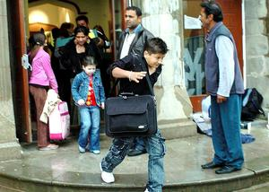 Romanians flee from Belfast City Church towards buses yesterday