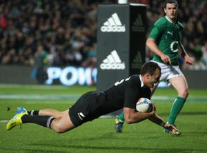HAMILTON, NEW ZEALAND - JUNE 23: Israel Dagg of the All Blacks scores a try during the International Test Match between New Zealand and Ireland at Waikato Stadium on June 23, 2012 in Hamilton, New Zealand.  (Photo by Sandra Mu/Getty Images)
