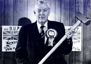 Ian Paisley at DUP HQ in 1985. The party leader held a sledge hammer to depict his 'smash Sinn Fein' message