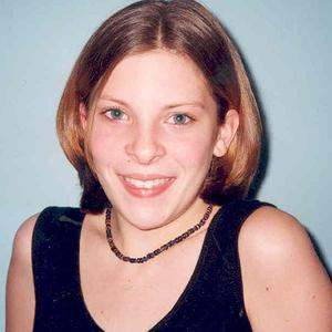 Surrey Police said an individual from the News of the World admitted in April 2002 that the paper had accessed Milly Dowler's voicemail