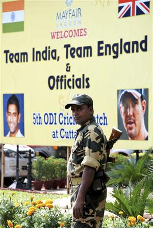 An Indian security person stands outside a hotel where the cricket teams of England and India are staying in Bhubaneswar, India, Thursday, Nov. 27, 2008. The remainder of England's limited-overs cricket tour of India has been scrapped and a Champions League Twenty20 tournament scheduled for next week is in doubt following terror attacks in Mumbai.(AP Photo/Biswaranjan Rout)