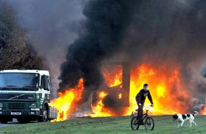 A forty foot lorry cab and trailer ablaze at `Tullygally this evening as a wave of hi-kackings in the Lurgan are followed the jailing of three local men for fifteen years each for possessing a horizontal mortor. The men were described in court as members of the CIRA - the dissident republican group that killed a policeman just around the corner from where the lorry was set alight. The main Belfast to Dublin railway line was closed after a hi-jacked van was set on fire across the railway line at Lurgan.