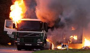 A lorry burns in the Drumbeg area of Lurgan, County Armagh following disturbances in the Craigavon area this evening. It comes after three men involved in a plot to kill police officers with a mortar bomb in Lurgan, County Armagh, were  jailed for 15 years this afternoon.