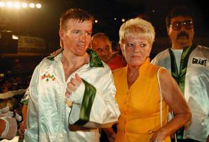 Alice Ward with her boxer son Micky after a fight in Boston in 1997