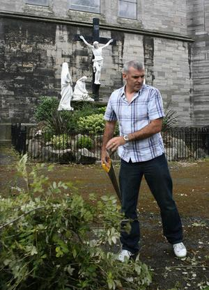 Local people begin a clean up operation of St Laurence O'Toole church in Dublin