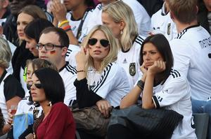 Bastian Schweinsteiger's girlfriend Sarah Brandner (C) and Silvia Meichel, girlfriend of Mario Gomez of Germany, during the 2010 FIFA World Cup South Africa Round of Sixteen match between Germany and England at Free State Stadium on June 27, 2010 in Bloemfontein, South Africa